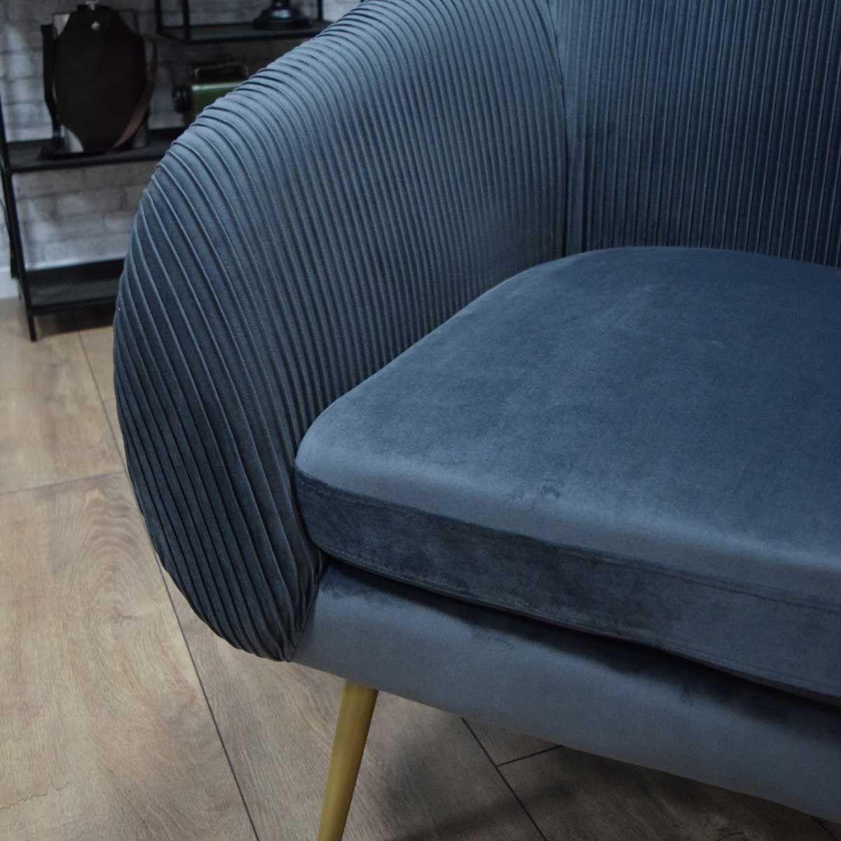 Fauteuil en velours plissé gris
